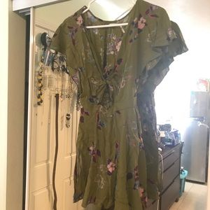 Green romper with flowers size small